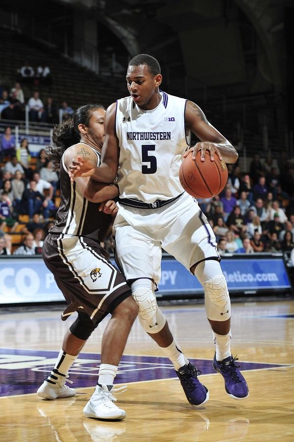 Dererk Pardon dribbles around a defender. The freshman center, who was forced to use his redshirt after Alex Olah injured his foot, erupted for 28 points and 12 rebounds Wednesday to lead the Cats to a comeback victory over Nebraska.