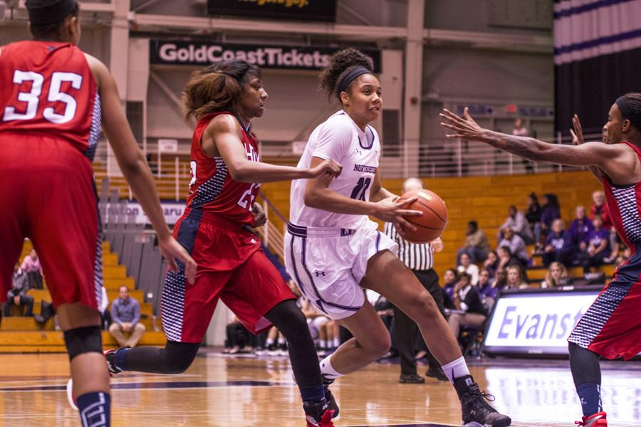 Nia Coffey drives through three defenders. The junior forward spent a startlingly high 11 minutes on the bench as the Wildcats drew 21 fouls against Loyola on Sunday.