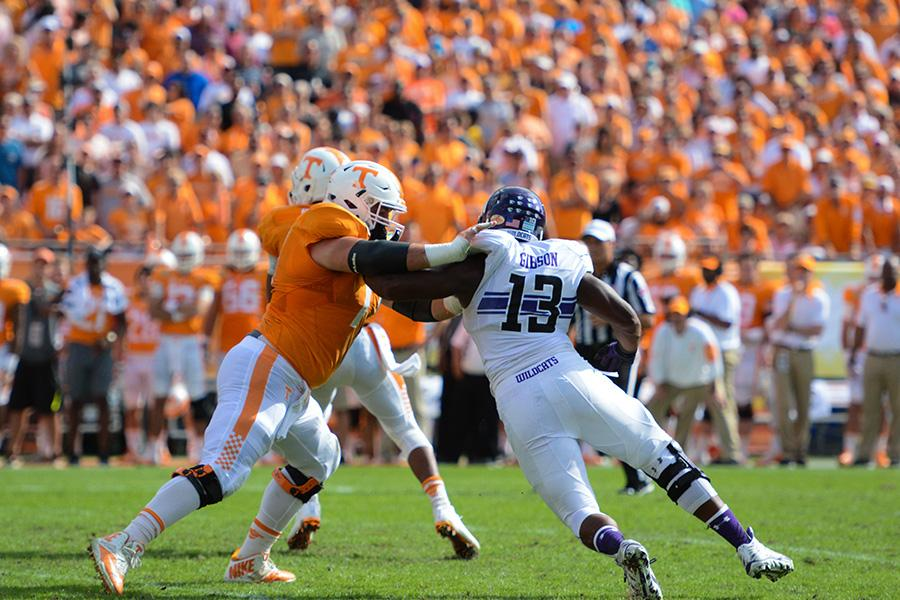 Senior defensive end Deonte Gibson battles against a Tennessee player. The Wildcat captain along with his senior teammates played their last game for Northwestern on Friday.