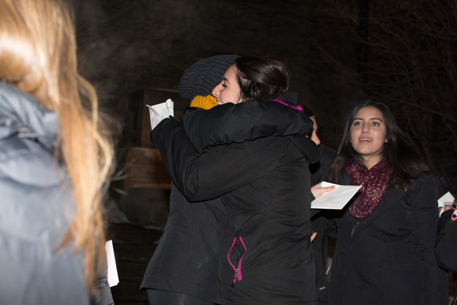 Two students embrace outside Technological Institute after receiving bids during Tuesday night's culmination of Panhellenic Association's winter recruitment. This year, PHA gave out more than 600 bids, while Interfraternity Council reported 383 dropped bids.