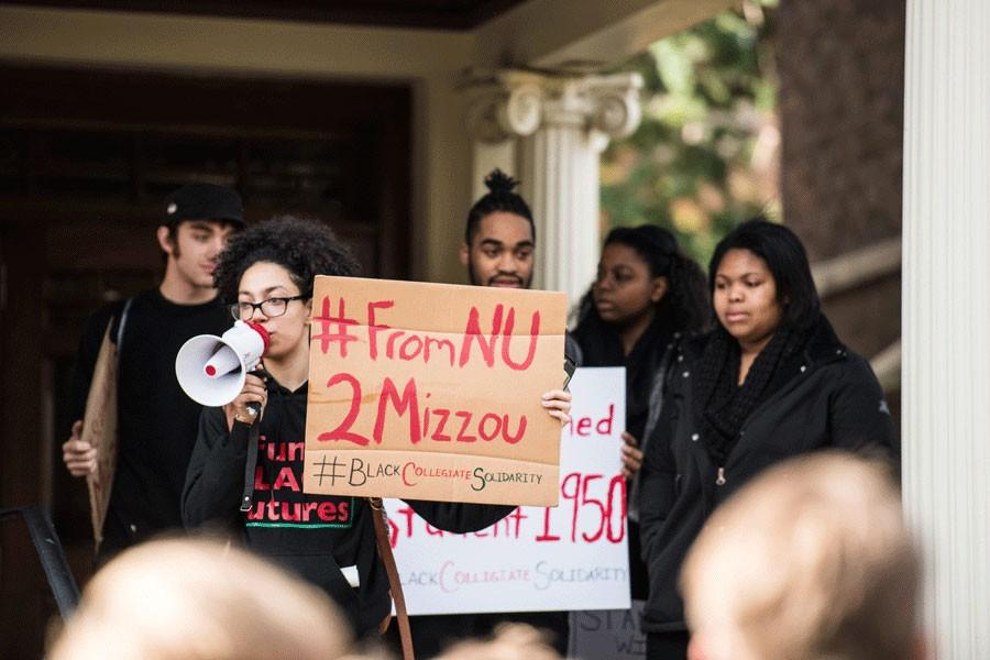 A+group+of+protesters+gather+outside+the+Black+House+on+Nov.+13.+Seven+students+were+selected+to+join+a+community+discussion+with+administrators+regarding+inclusion+issues+on+campus+after+students+sent+a+list+of+demands+for+a+more+inclusive+campus+to+administrators.+