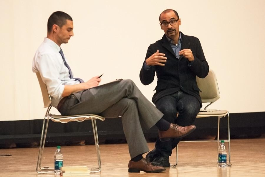 Pulitzer Prize-winning author Junot Diaz (right) speaks about the importance of compassion in overcoming immigrant challenges. His talk, held at Ryan Family Auditorium on Thursday, was moderated by English Prof. John Alba Cutler.