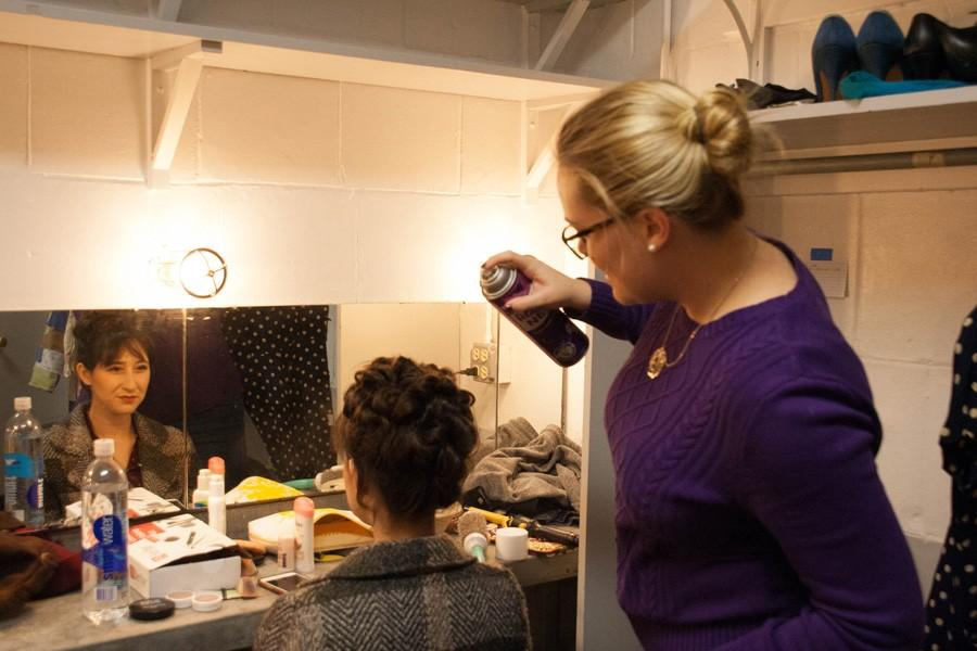 "Keebler Straz, hair and makeup designer for ""Gypsy,"" works on the hairstyle of one of the show's cast members. This year over 150 students help put together the 74th annual Dolphin Show."