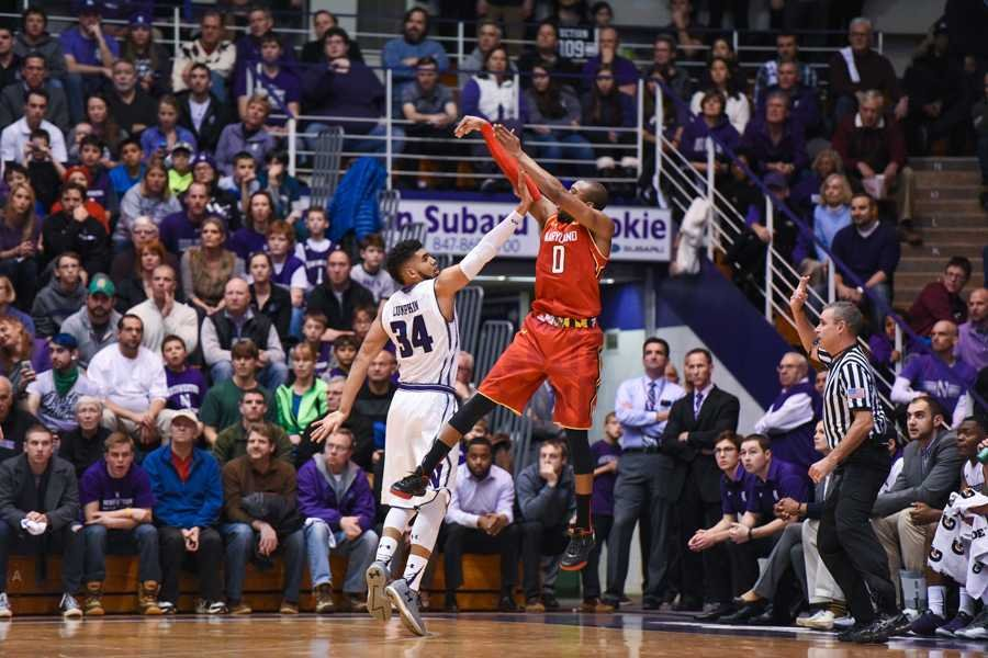Maryland guard Rasheed Sulaimon shoots a jumper over junior forward Sanjay Lumkpin. The Maryland backcourt scored 40 of the Terrapins' 72 points.