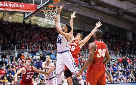 Sanjay Lumpkin fights for the shot. The junior forward scored 9 points to help Northwestern earn its first home conference win of the season against Wisconsin.