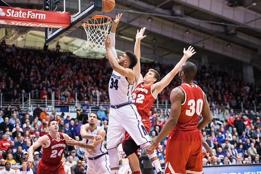 Sanjay+Lumpkin+fights+for+the+shot.+The+junior+forward+scored+9+points+to+help+Northwestern+earn+its+first+home+conference+win+of+the+season+against+Wisconsin.