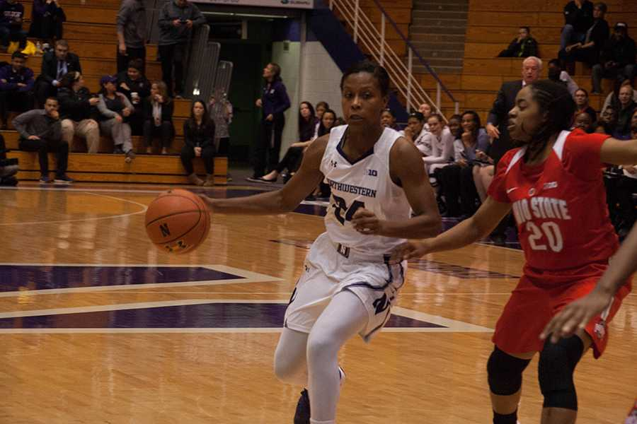 Christen Inman drives toward the basket. The junior guard performed well in Northwestern's game at Minnesota, scoring 15 points in the loss.