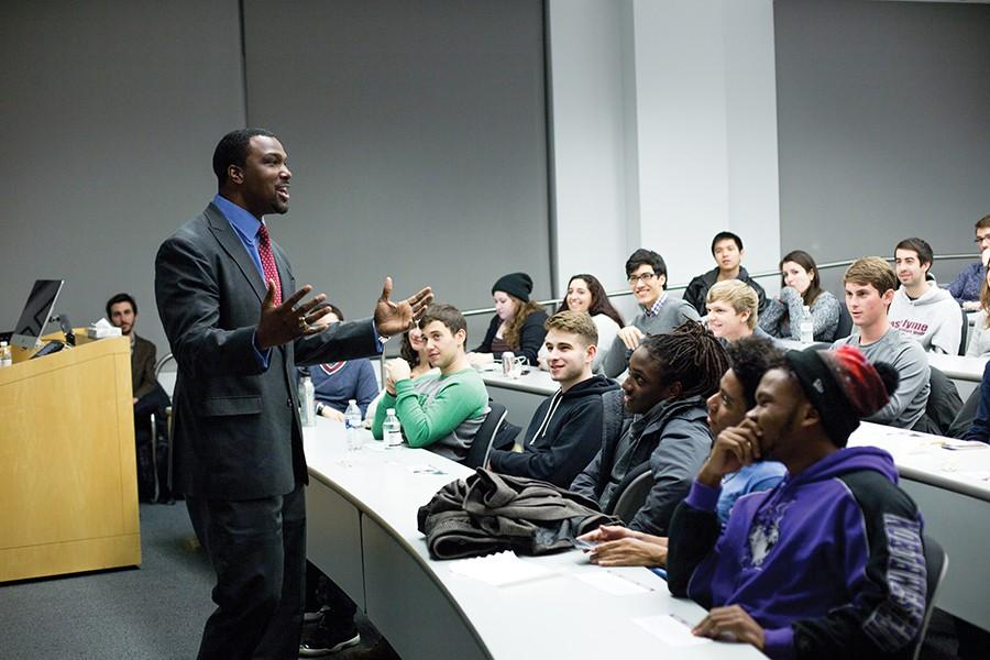 Illinois State Senator Napoleon Harris speaks Tuesday night in the McCormick Foundation Center on his transition from pro-football to politics. The event featured a lengthy Q&A in which students asked questions about education inequality, police brutality and campus protests.