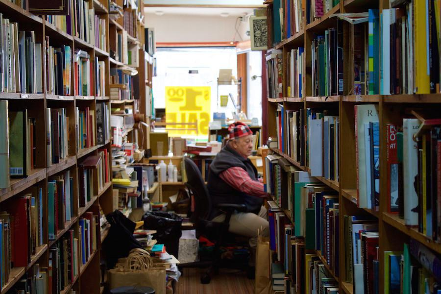 Howard+Cohen+sits+in+his+bookstore%2C+Howard%E2%80%99s+Books%2C+which+is+set+to+close+at+the+end+of+next+month.+The+bookstore+has+been+an+Evanston+institution+for+35+years.