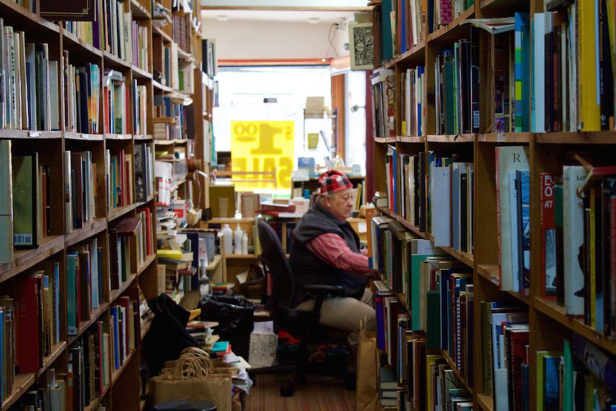 Howard Cohen sits in his bookstore, Howard's Books, which is set to close at the end of next month. The bookstore has been an Evanston institution for 35 years.