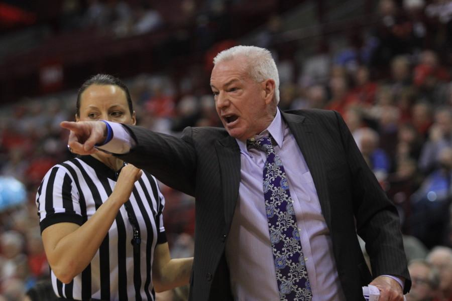 Joe McKeown speaks with the referee. The coach almost led the Wildcats to another upset of Ohio State on Thursday.