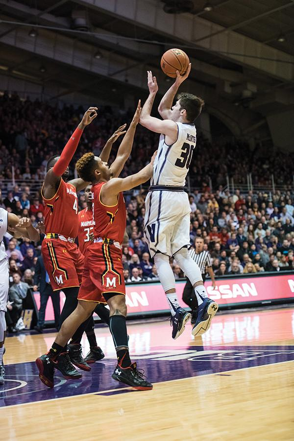 Bryant McIntosh shoots the ball over the defense. The sophomore guard has averaged over 35 minutes per game this season, second-most on the team.