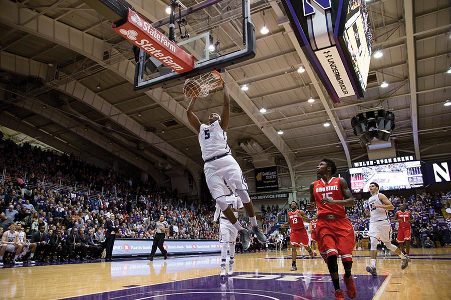 Dererk Pardon dunks the basketball. The freshman center helped key one of Northwestern's early Big Ten games against Nebraska, setting his own personal records of 28 points.