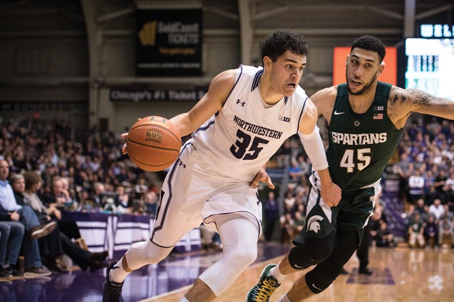 Aaron+Falzon+drives+from+the+perimeter.+The+freshman+forward+was+held+scoreless+in+Sunday%E2%80%99s+loss+to+No.+3+Iowa%2C+shooting+0-for-8+from+the+field.
