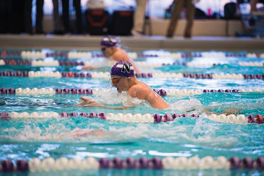 Thanas Kountroubis furiously races to the other wall. The freshman is one of three Wildcats that compete in breaststroke events.