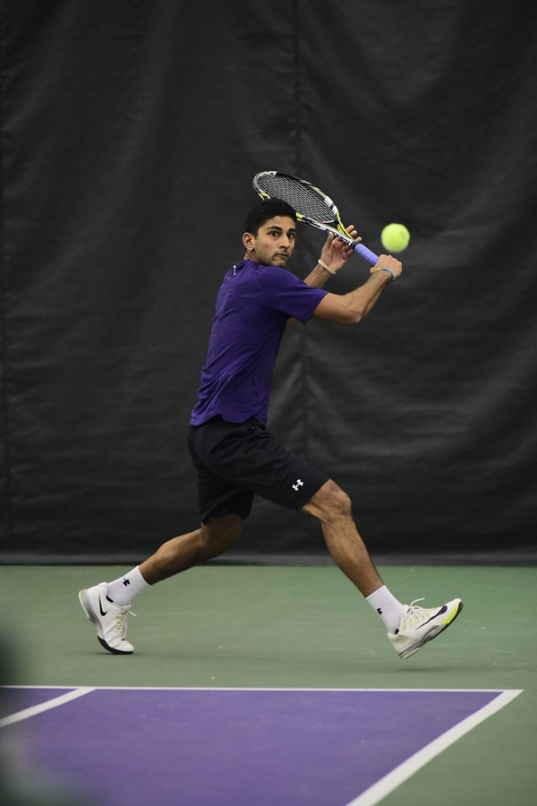 Mihir Kumar returns his opponent's shot. The senior will play a big part in the Wildcats's upcoming matches this weekend when they face multiple elite schools.