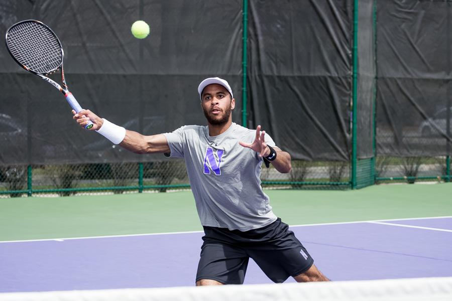 Sam Shropshire returns the ball with a volley. The junior lost in straight sets during his singles match against Illinois on Saturday.