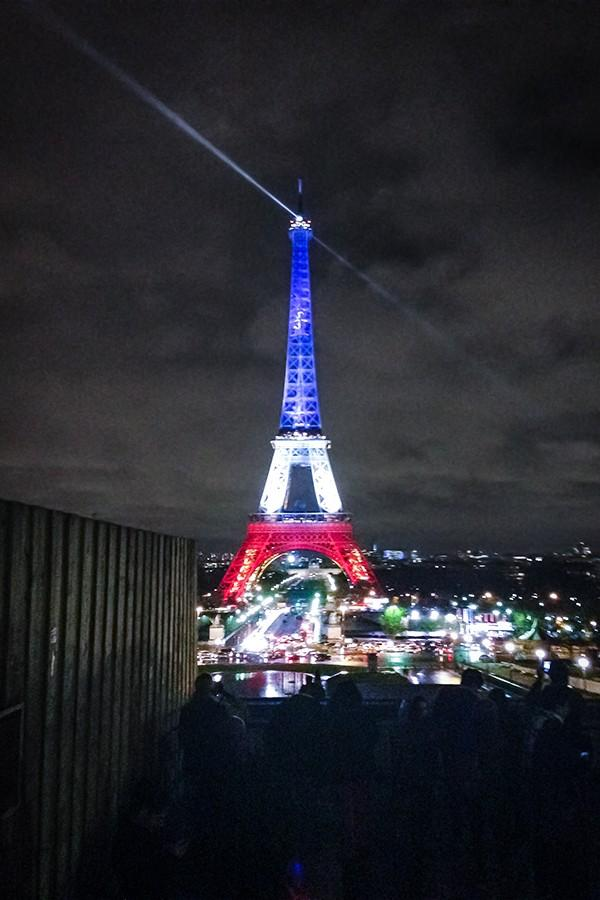"The Eiffel Tower lit up following terrorist attacks in Paris that left 130 dead and many more wounded. Northwestern study abroad students reported mixed responses to University action following the attacks, which included counseling services, ""interfaith reflection"" and flexible work deadlines."
