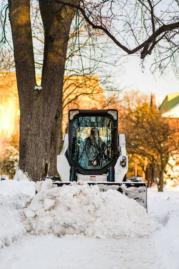 A plow clears away piles of snow during a blizzard that swept through the Chicago area last February. The storm ranked as the area's fifth worst snowstorm in history and caused Evanston to declare a snow emergency for two days.