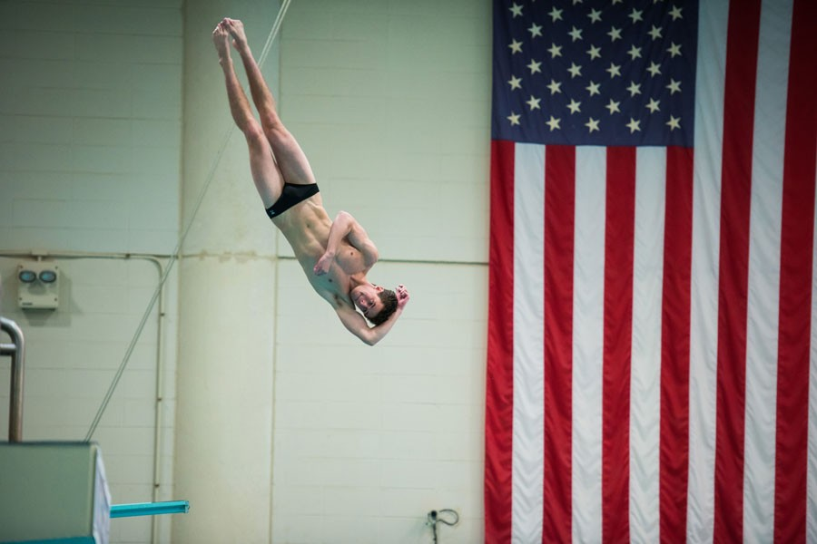 Damian+Becker+contorts+his+body+while+diving.+The+freshman+will+be+a+big+factor+if+Northwestern+wants+to+win+the+diving+portion+of+the+match.