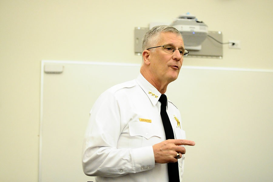 Evanston Police Chief Richard Eddington talks with community members about gun violence. Eddington presented at City Council Monday night about obtaining tasers equipped with cameras for the city's officers.