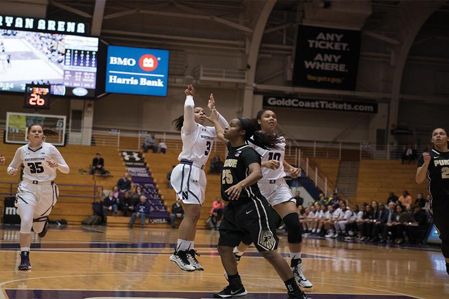 Ashley Deary lifts a jump-shot. Despite the Wildcats' struggles, the junior guard leads the nation in steals per game.