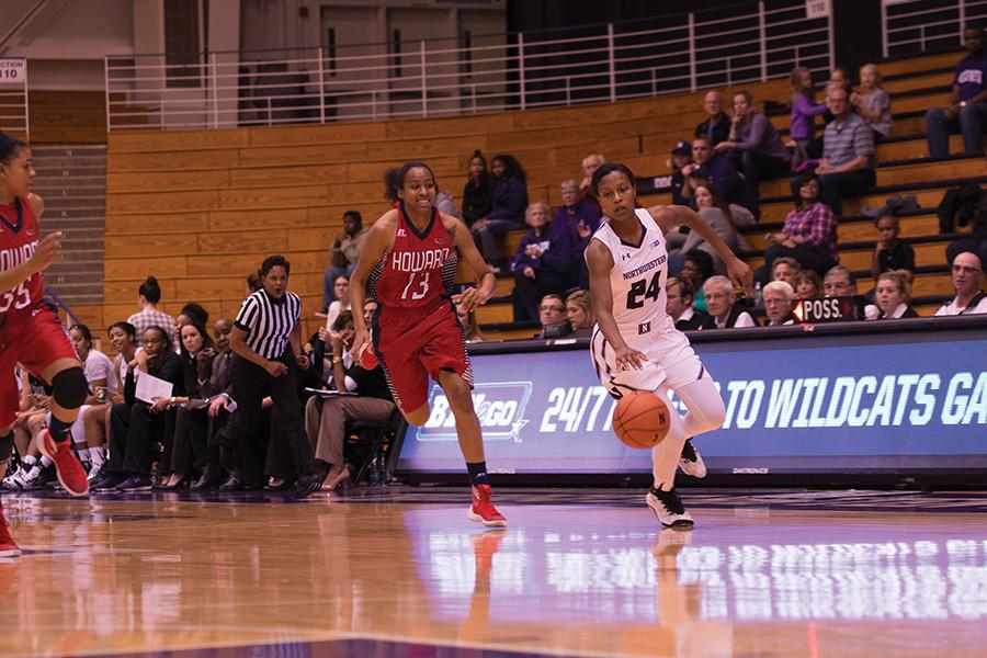 Junior guard Christen Inman dribbles up the court. The Wildcats fell to No. 16 in the AP Poll after a loss to Penn State and a victory over Nebraska last week.
