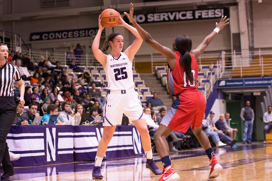 Maggie Lyon prepares to pass to the paint. Through 14 games, the senior guard is averaging a career-high 15.4 points per game.