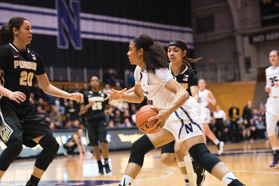Nia Coffey handles the ball. The junior forward has had a big season for the Wildcats, but struggles at the start of the conference season have dealt a blow to NU's NCAA Tournament hopes.
