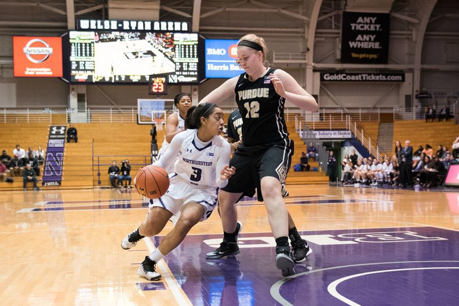 Ashley+Deary+dribbles+around+a+defender+in+the+paint.+Deary+and+the+Wildcats+have+struggled+with+depth+this+season%2C+evidenced+by+Northwestern%E2%80%99s+2+bench+points+on+Thursday.
