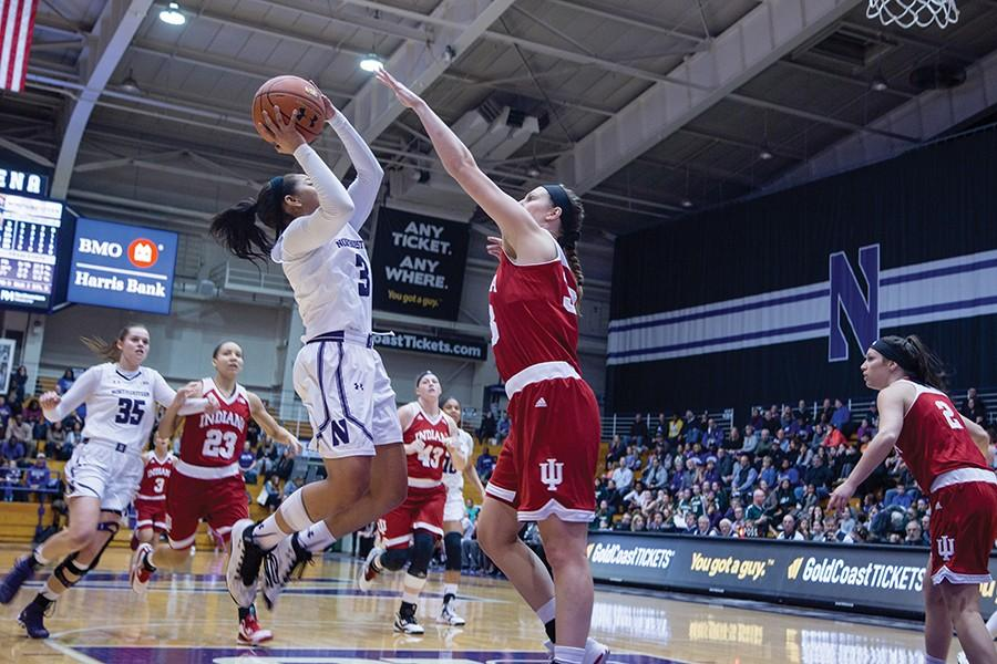 Ashley Deary rises for a layup attempt. The diminutive junior guard led the way for the Wildcats against Indiana, scoring a career-high 28 points and dishing 10 assists.