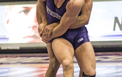 Luke Norland wrestles with an opponent. The freshman will be looking to rebound from his 6-0 loss two weeks ago.