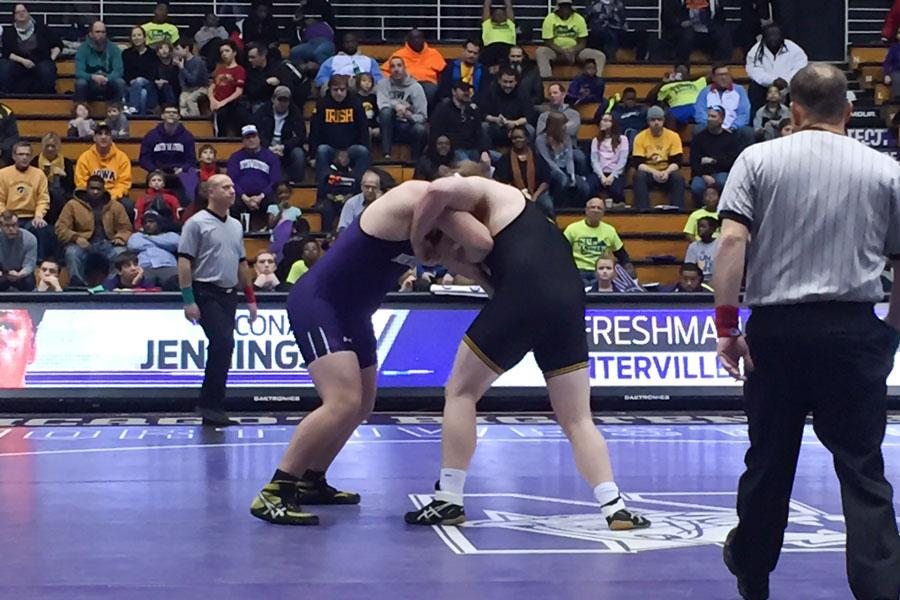 Conan Jennings grapples with an opponent. The redshirt freshman was pinned in his match, one of many defeats for NU en route to a 54-0 shutout against No. 2 Iowa.