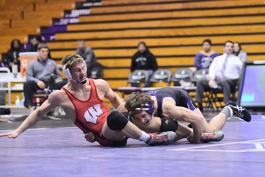 Jason+Tsirtsis+grabs+the+leg+of+his+opponent.+The+junior+was+one+of+only+a+few+Wildcats+that+won+in+a+weekend+where+NU+fell+to+both+Michigan+and+Michigan+State.+