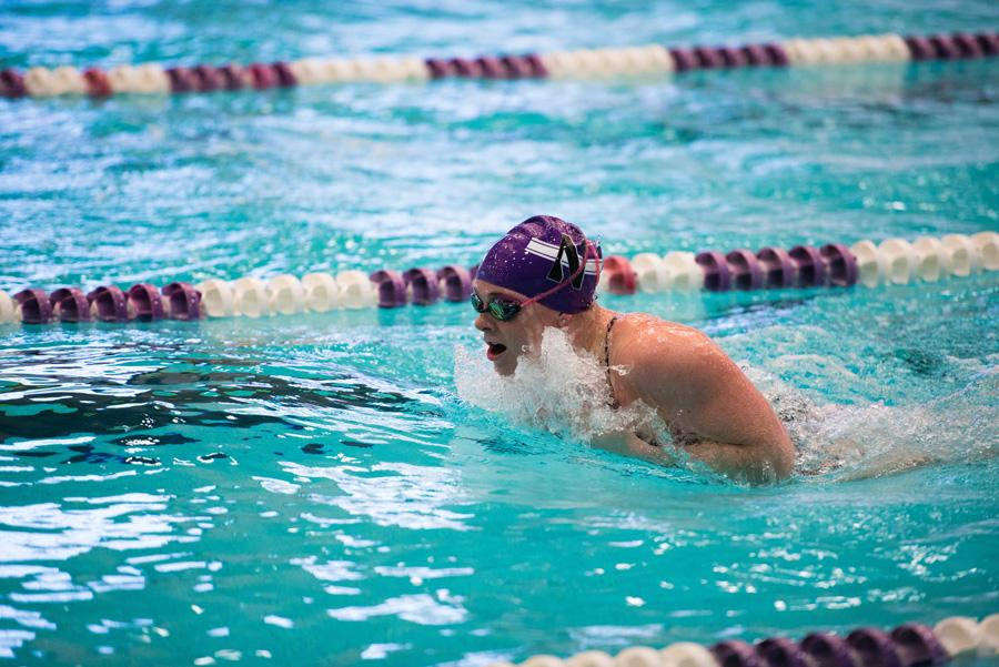 Georgie Pettibone competes in the breaststroke. The junior finished in sixth place in the 200 yard breaststroke against Iowa, more than seven seconds behind first place.