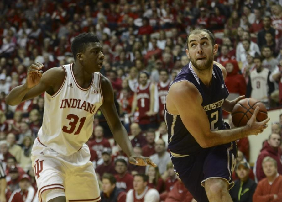 Alex Olah muscles around a Hoosier defender. The senior, playing in his most minutes since returning from a foot injury, led the Wildcats with 19 points in Saturday's loss.