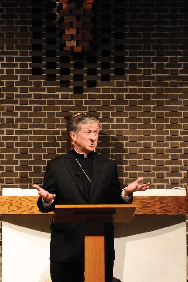 Archbishop Blase Cupich educates an audience at Sheil Catholic Center about Pope Francis. Cupich's talk to an audience of about 80 people marked his first visit to Sheil.