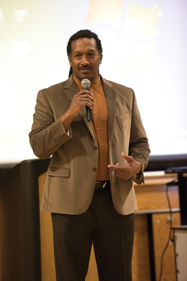 Dr. Gilo Kwesi Logan leads a discussion about diversity and inclusion efforts from the Evanston Police Department at the Levy Center, 300 Dodge Ave., on Tuesday night. More than 50 residents, officers and city officials attended the event.