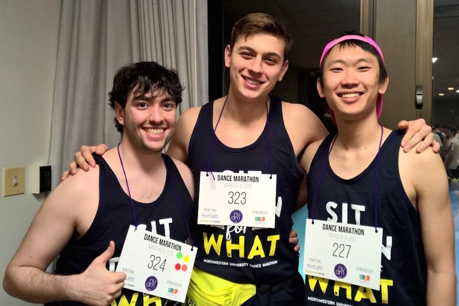 Zachary Elvove, left, stands with friends at Dance Marathon. Elvove, whose dad helped bring DM to Northwestern in 1975, has raised more than $6,500 throughout the past three years for DM.