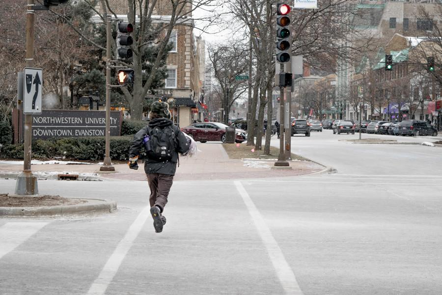 A man jogs against a red light down Sherman Avenue toward downtown Evanston. The 1st Ward encompasses much of the city's downtown area, and is nestled just to the south and west of Northwestern University.