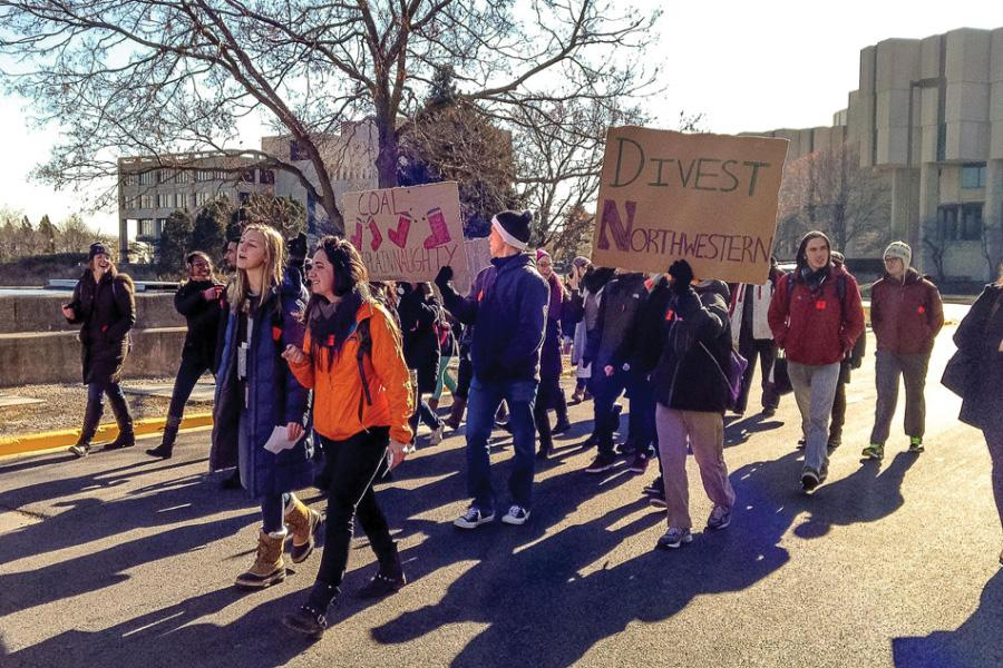 Students protest Northwestern's investments in the coal industry in 2014. Members of Fossil Free Northwestern, the group pushing for divestment from coal, oil and gas companies, have been fighting against the University's investment in the fossil fuel industry for years.