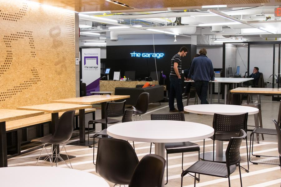 People convene at the cafe of The Garage, Northwestern's startup innovation hub. The Garage was launched June 2015 as a workspace for student entrepreneurs.