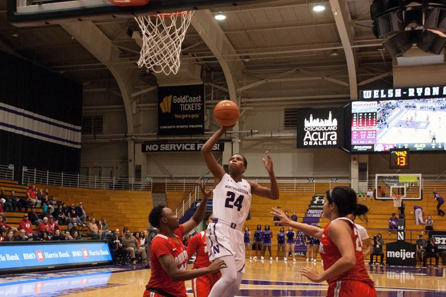 Christen Inman leaps toward the basket. The junior guard recently reached 1,000 career points and has been a lynchpin in NU's lineup since her freshman year.