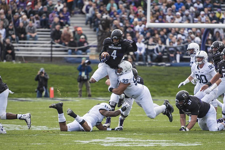 Solomon Vault hurdles a Penn State defender. The sophomore will see more opportunities in open space as he transitions to wide receiver.