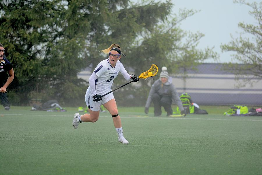 Christina Esposito cradles the ball in her stick. The junior has tallied three assists thus far in the 2016 season.