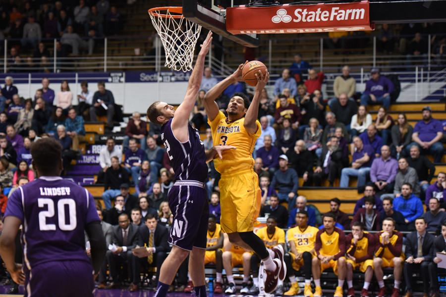 Alex Olah attempts to block an opposing player. The senior has not started Northwestern's past two games as coach Chris Collins went with freshman Dererk Pardon in his place.