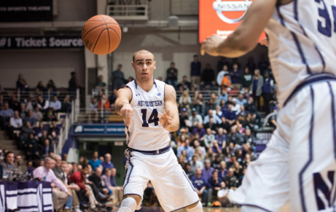 Tre Demps passes the ball to a teammate. The senior guard struggled earlier this season, but scored a career-high 30 points Sunday against Iowa.