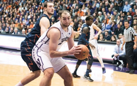 Alex Olah grabs the ball in the paint. The senior center struggled in last year's matchup with Purdue, scoring only 4 points.