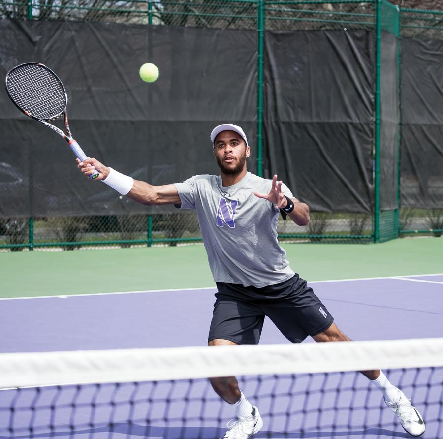 Sam Shropshire reaches for a volley. The junior won both his singles and doubles matches last weekend against Duke.