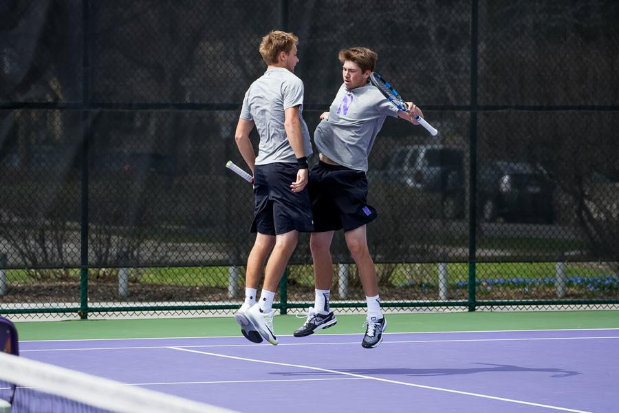 Strong Kirchheimer (right) celebrates with a teammate. The junior will look to help lead Northwestern on Saturday when it will play its first home match in more than two weeks against Kentucky.